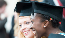 Image of Graduating students smiling for a photograph